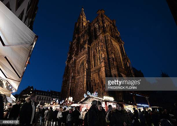 People visit on November 28 2015 the Christmas market in front of the cathedral of Strasbourg one of the largest and oldest Christmas market in...