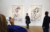People visit Paris's Picasso Museum on October 25 2014 at the Hotel Sale in Paris on the day of its reopening after a fiveyear closure for what was...
