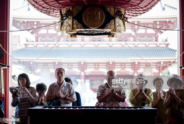 People visit Sensoji in Asakusa to pay their respect and pray on September 1 2013 in Tokyo Japan Completed in the year 645 making it the oldest and...
