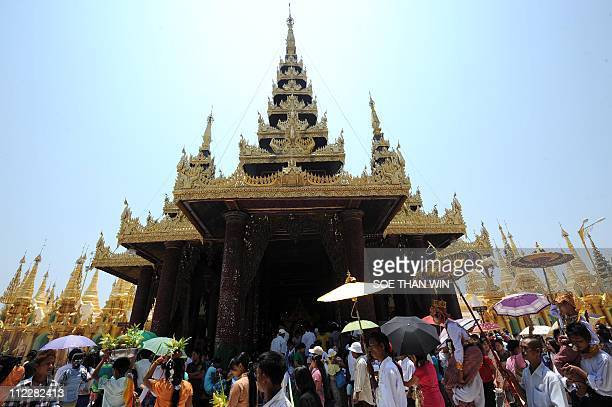 People visit Shwedagon pagoda during the Thingyan festival in Yangon on April 17 2011 Thingyan celebrates the beginning of the Myanmar lunar new year...