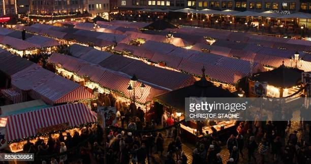 People visit stands as the traditional Christmas Market opens in Nuremberg southern Germany on December 1 2017 The traditional 'Nuernberger...