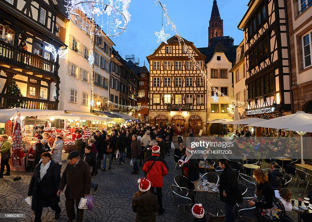 People visit Strasbourg's Christmas market, one of the largest and one of the eldest French Christmas markets, on November 24, 2012 in Strasbourg, eastern France, on the event's opening day. With over 300 market chalets, Strasbourg attracts over 1.6 million visitors during the Christmas season. AFP PHOTO / PATRICK HERTZOG