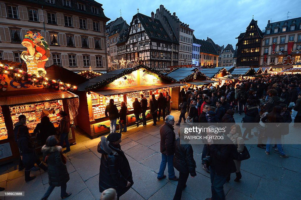 People visit Strasbourg's Christmas market, one of the largest and one of the eldest French Christmas markets, on November 24, 2012 in Strasbourg, eastern France, on the event's opening day. With over 300 market chalets, Strasbourg attracts over 1.6 million visitors during the Christmas season.
