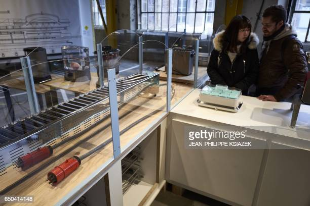 People visit the 10th SaintEtienne International Design Biennial on March 9 2017 at the SaintEtienne Cite du Design site formerly the Arms...