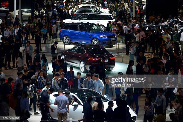 People visit the 16th Shanghai International Automobile Industry Exhibition in Shanghai on April 23 2015 Chinese technology giants Alibaba and...