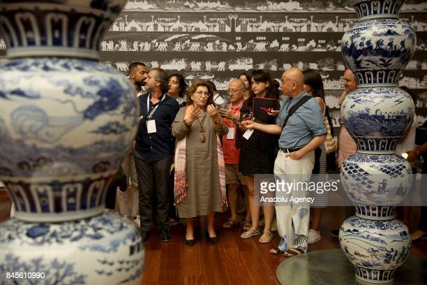 People visit the 'Ai Weiwei on Porcelain' exhibition after the a press conference that held by Ai Weiwei the most famous Chinese artist Suzan Sabanci...
