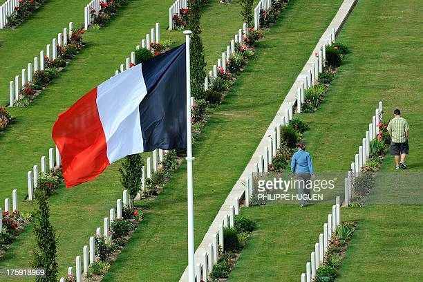 People visit the Australian cemetery of VillersBretonneux World War I memorial on August 102013 in Villers Bretonneux AFP PHOTO PHILIPPE HUGUEN