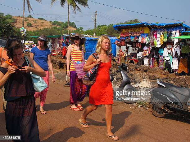 People visit the beach town of Goa India's popular hippyhappy beach destination which has now become the hub of international drug trafficking A drug...