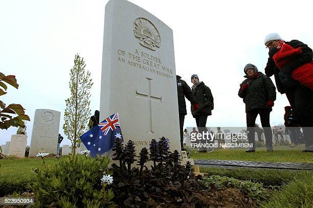 People visit the cemitery of the Australian Memorial of the World War I battle of the Somme in VillersBretonneux on April 25 2016 during the Anzac...
