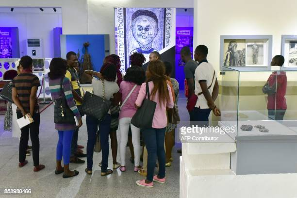 People visit the Civilisation Museum of Abidjan on September 29 2017 during the first exhibition called 'Renaissance' following the renovation of the...