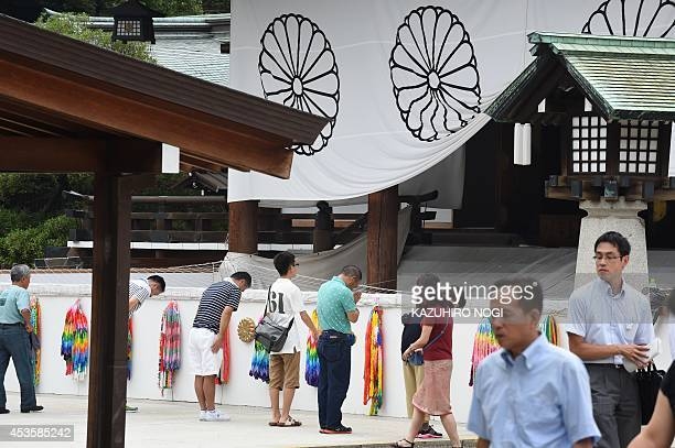 People visit the controversial Yasukuni Shrine in Tokyo on August 14 one day before the 69th anniversary of Japan's surrender in World War II An...