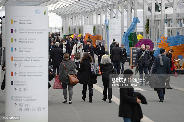 people visit the COP21 climate summit's venue at Le Bourget northeast of Paris on November 29 2015 Some 150 leaders will attend the start on November...