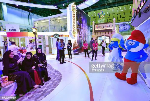 People visit the Dubai Parks and Resorts pavilion during the Arabian Travel Market 2017 at the Dubai World Trade Centre on April 24 2017 / AFP PHOTO...