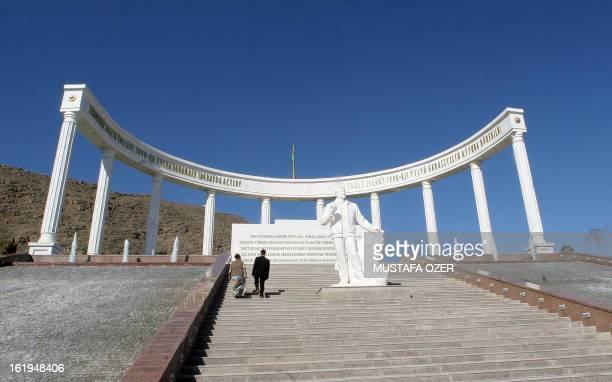 People visit the earthquake memorial in Ashgabat 13 February 2007 AFP PHOTO / MUSTAFA OZER