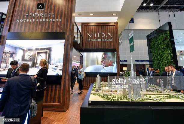 People visit the Emaar Hospitality Group stand during the Arabian Travel Market 2017 at the Dubai World Trade Centre on April 24 2017 / AFP PHOTO /...