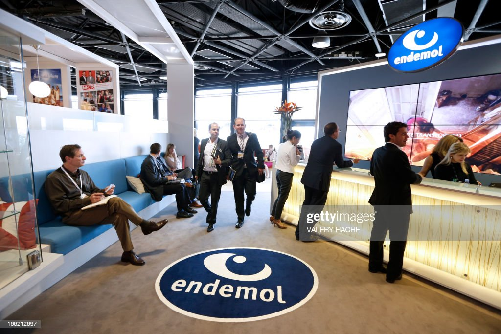 People visit the Endemol Tv production company stand at the MIPTV one of the world's largest broadcasting and audio-visual trade show, on April 10, 2013 in Cannes, southeastern France .