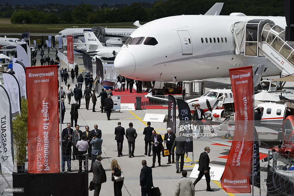 People visit the European Business Aviation Convention & Exhibition (EBACE) on May 24, 2016 in Geneva. COFFRINI