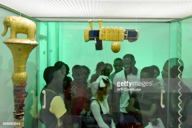 People visit the exhibited at the Civilisation Museum of Abidjan on September 29 2017 during the first exhibition called 'Renaissance' following the...