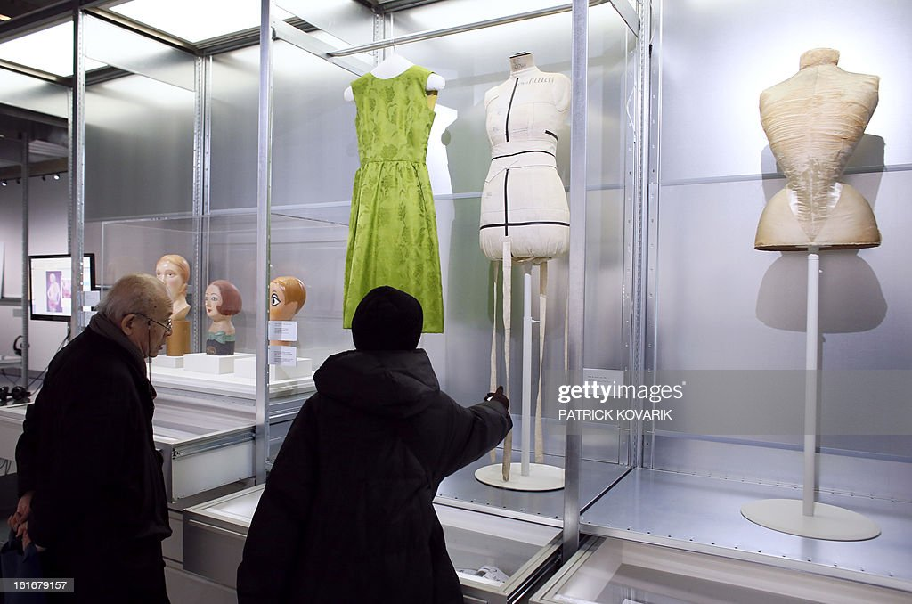 People visit the exhibition 'Mannequin, le Corps de la Mode' at the cite de la mode fashion museum in Paris, on February 14, 2013. AFP PHOTO PATRICK KOVARIK