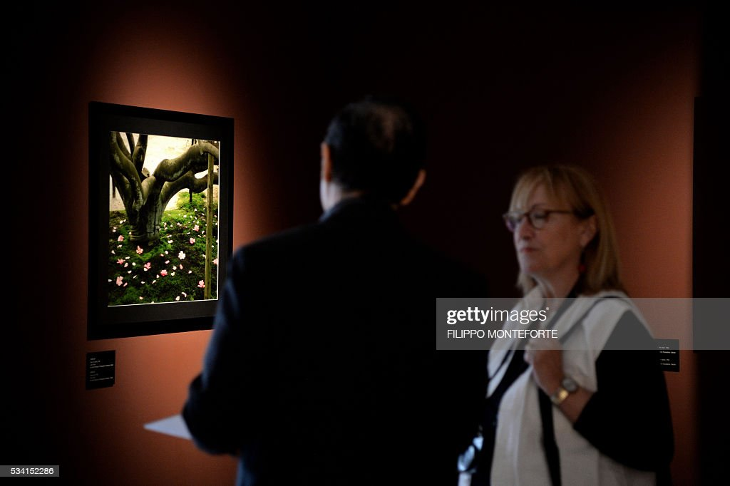 People visit the exhibition of Japanese photographer Domon Ken (1909-1990) during a press preview at the Ara Pacis Museum (Museo dell'Ara Pacis) on May 25, 2016 in Rome. The show will run from May 27, 2016 to September 18, 2016 to mark 150th years of friendship between Japan and Italy. / AFP / FILIPPO