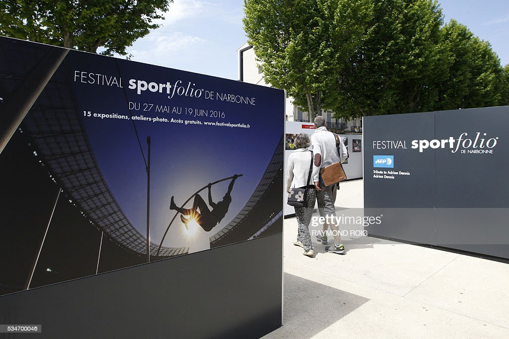 People visit the exhibition tribute to AFP Adrian Denis as part of the Sportfolio festival, a festival dedicated to sport photography,on May 27, 2016 in Narbonne, southern France. / AFP / RAYMOND
