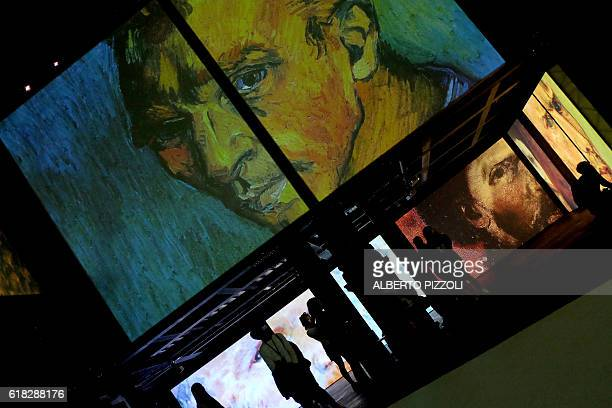 People visit the exhibition 'Van Gogh Alive The Experience' life and work of Vincent Van Gogh from 1880 until 1890 on October 26 2016 in Rome...