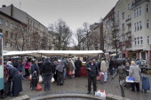 People visit the farmer's market on the KarlMarxPlatz in Neukoelln district on November 02 2013 in Berlin Germany Halil Ilhan lives for 30 years in...