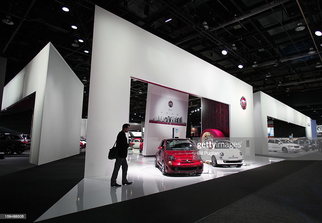 People visit the Fiat exhibit at the 2013 North American International Auto Show media preview at the Cobo Center January 14, 2013 in Detroit, Michigan. Approximately 6,000 members of the media from 68 countries are attending the show this year. The 2013 NAIAS opens to the public January 19th.
