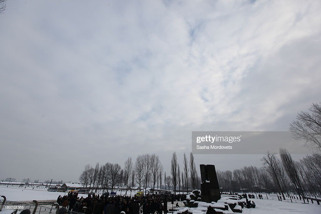 People visit the former Auschwitz Birkenau Nazi concentration camp January 27, 2013 near Oswiecim, Poland. A ceremony marked the 68th anniversary of the liberation of the camp during International Holocaust Remembrance Day.