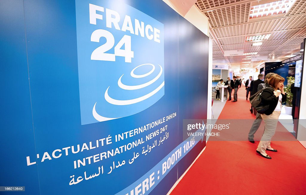 People visit the France 24 international news TV stand at the MIPTV one of the world's largest broadcasting and audio-visual trade show, on April 10, 2013 in Cannes, southeastern France .