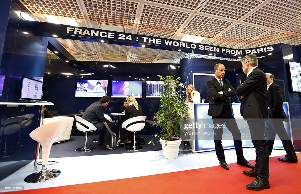 People visit the France 24 stand at the MIPTV one of the world's largest broadcasting and audio-visual trade show, on April 10, 2013 in Cannes, southeastern France .