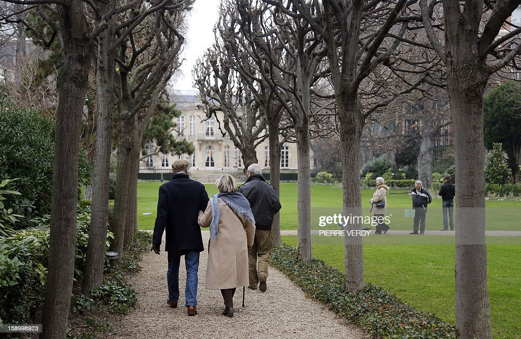 People visit the French Prime minister residency Hotel Matignon's garden, on January 5, 2013 in Paris. The garden is now open to visitors the first saturday of each month.