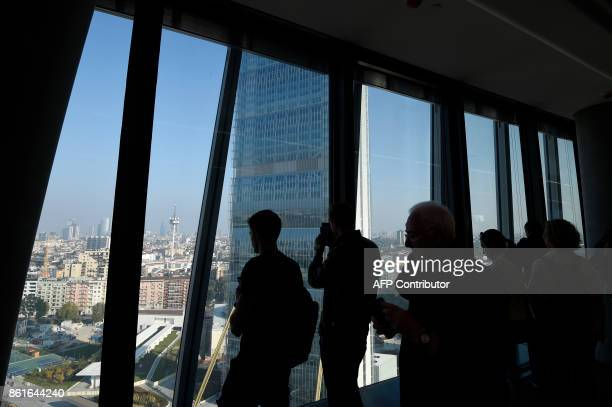 People visit the Generali tower also called Hadid tower designed by Zaha Hadid studio in the Citylife neighborghood western Milan on October 15 2017...