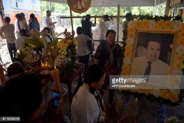 People visit the grave of Cambodian critic Kem Ley during the first anniversary of his murder at his mother's home in Takeo province on July 9 2017...