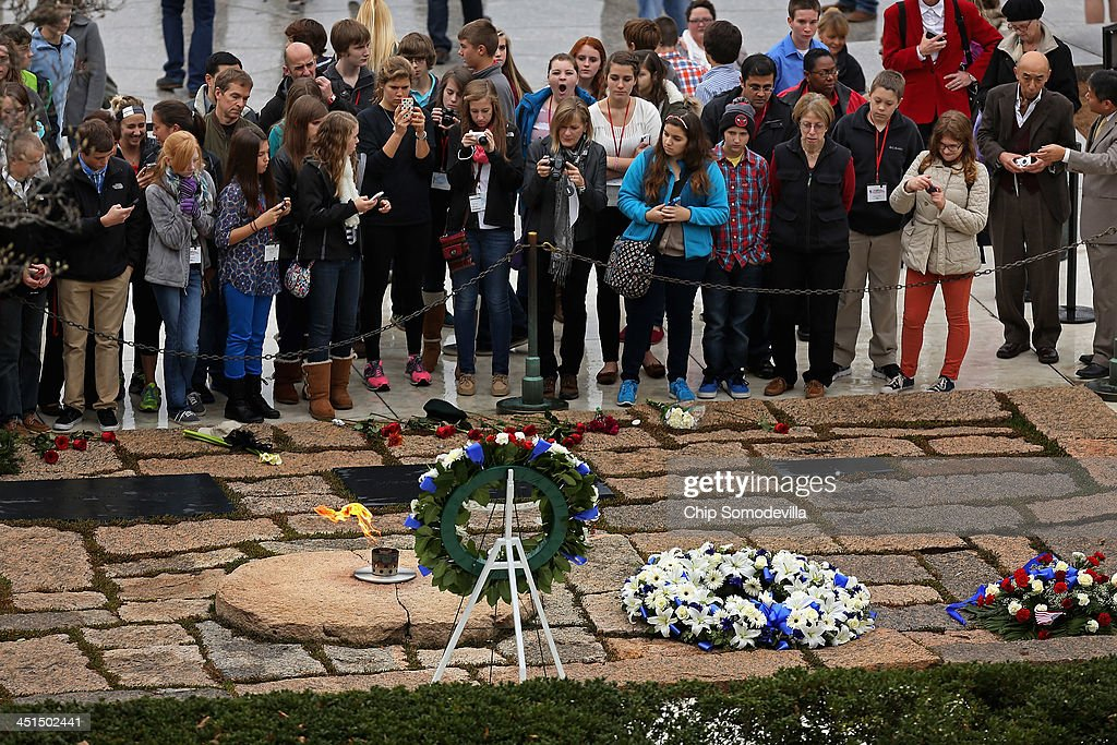 People visit the gravesite of former U.S. President John F. Kennedy at Arlington National Cemetery November 22, 2013 in Arlington, Virginia. Remembrance ceremonies will be held arcoss the United States today, the 50th anniversary of the assisination of President Kennedy.