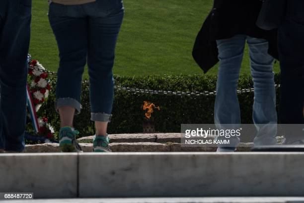 People visit the gravesite of John F Kennedy at Arlington National Cemetery in Arlington Virginia on May 25 ahead of the May 29th birth centennial of...