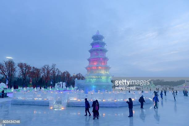 People visit the Harbin International Ice and Snow Festival in Harbin northeast China's Heilongjiang province on January 5 2016 Over one million...