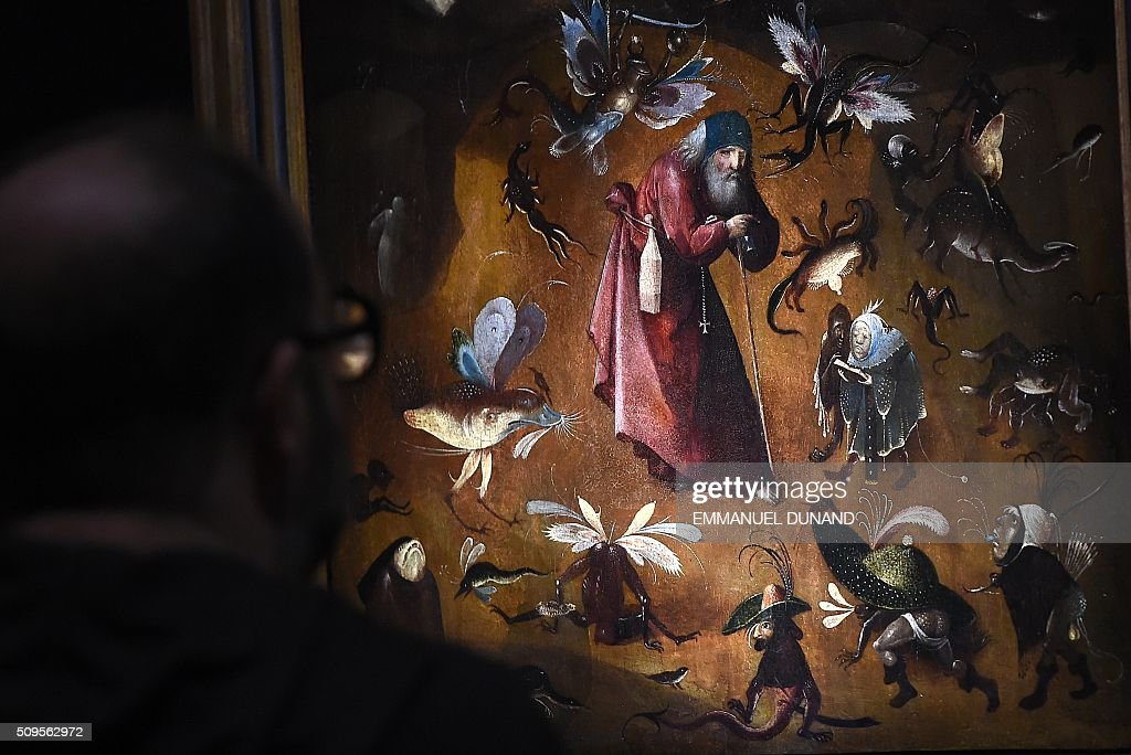People visit the 'Hieronymus Bosch, Visions of a Genius' exhibition during a press preview at the Noordbrabants Museum in Den Bosch on February 11, 2016. To mark the 500th anniversary of Dutch painter Hieronymus Bosch's death, a small museum in his hometown has managed to bring most of the last 25 known surviving paintings by the man dubbed 'the devil's painter' for a major exhibition of his work scheduled from February 13 to May 8, 2016. / AFP / EMMANUEL DUNAND