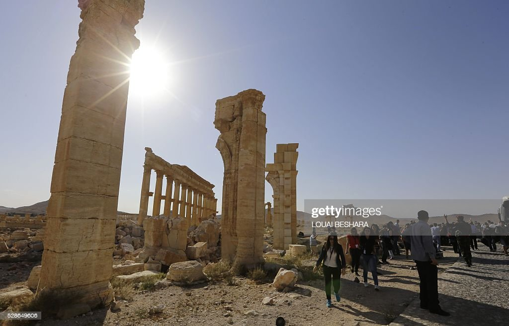 People visit the historical site of the ancient theatre of Syria's ravaged Palmyra on May 6, 2016 ahead of a music concert following its recapture by regime forces from the Islamic State group fighters. Syrian troops backed by Russian air strikes and special forces on the ground recaptured UNESCO world heritage site Palmyra from Islamic State (IS) group fighters in March 2016. BESHARA