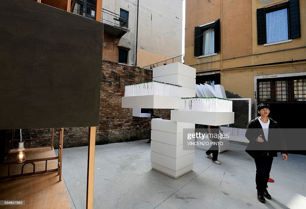 People visit the Hong Kong pavillion as part of the Collateral Events 'Stratagems in Architecture' during the 15th International Architecture Exbition (Biennale) in Venice on May 27, 2016. / AFP / VINCENZO