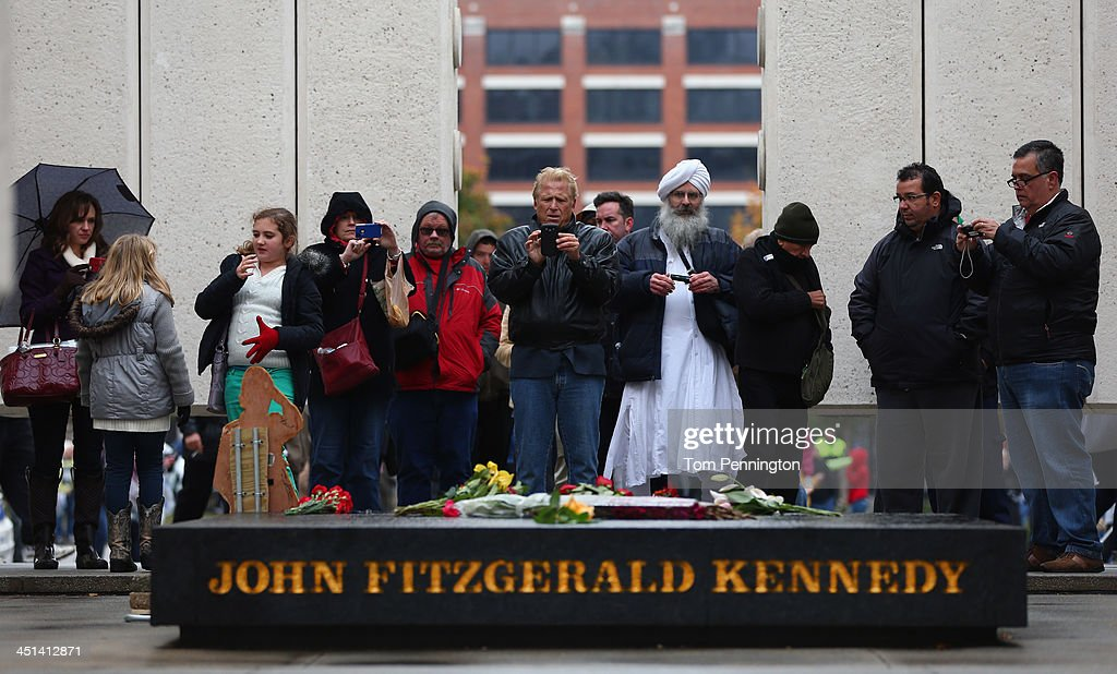 People visit the John F. Kennedy Memorial Plaza on November 22, 2013 in Dallas, Texas. Visitors streamed through the memorial on the 50th anniversary of the assassination of U.S. President John F. Kennedy as he rode in a Presidential motorcade in Dealey Plaza.
