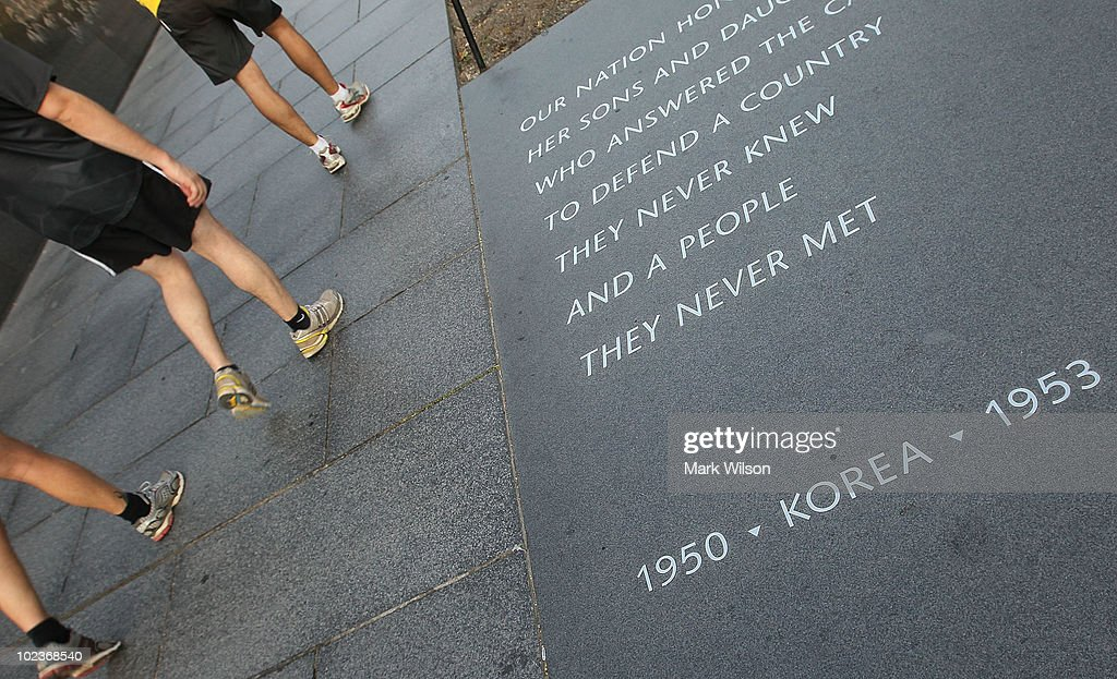 People visit the Korean War Memorial on June 24 2010 in Washington DC Sixty years ago today North Korean troops marched across the 38th parallel into...
