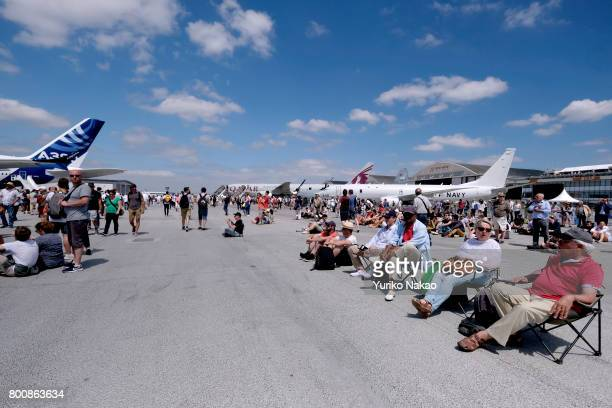People visit the Le Bourget Airport on the first public day of the 52nd International Paris Air Show on June 23 in Paris France