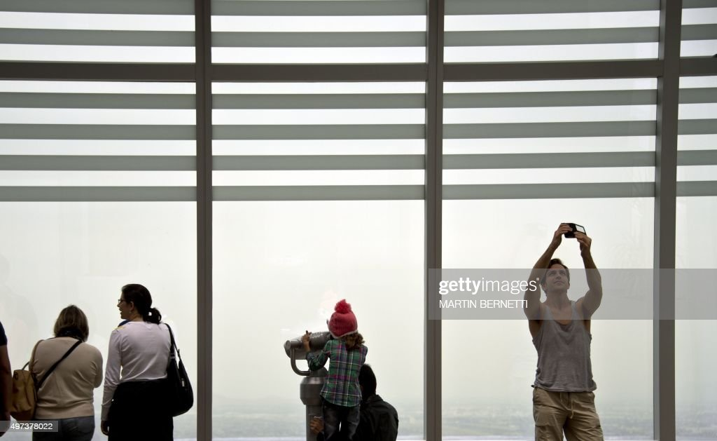 People visit the lookout of the Costanera Center tower in Santiago on November 16, 2015. The Costanera Cernter has the highest lookout in South America, with a height of 300 meters and a 360 degrees panoramic view.