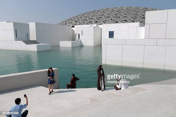 People visit the Louvre Abu Dhabi displaying 600 art pieces including 300 artworks rented from the Louvre in Abu Dhabi UAE on November 11 2017