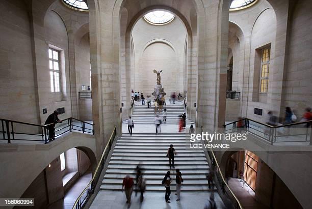 People visit the Louvre museum on June 17 in Paris AFP PHOTO LOIC VENANCE