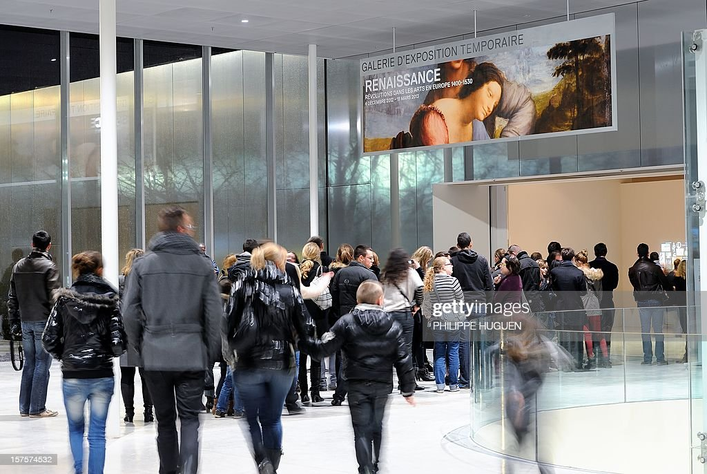 People visit the Louvre Museum on the first day of its opening to the public on December 4, 2012 in Lens, northern France