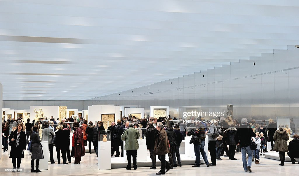 People visit the Louvre-Lens museum on December 31, 2012 in Lens, northern France. Three weeks after its inauguration, the museum welcomed its 100.000th visitor on December 28, 2012.