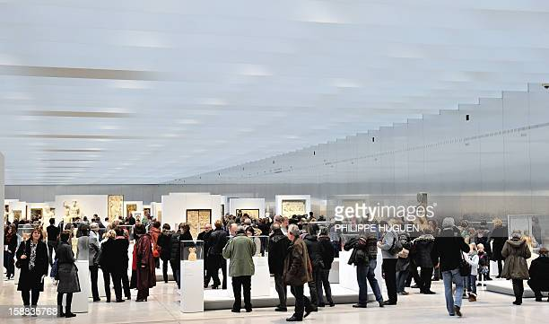People visit the LouvreLens museum on December 31 2012 in Lens northern France Three weeks after its inauguration the museum welcomed its 100000th...