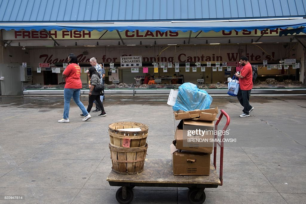 People visit the maine avenue fish market along the for Maine fish market